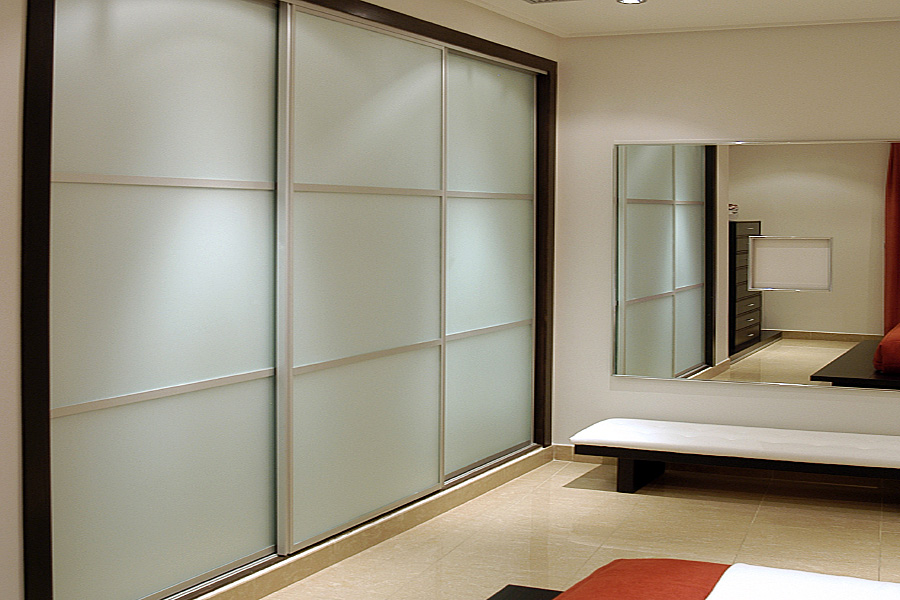 Sliding wardrobe door frames advice for beautiful framed wardrobes raise the wardrobe doors on a plinth to match your skirting board with or without a chunky frame planetlyrics Gallery